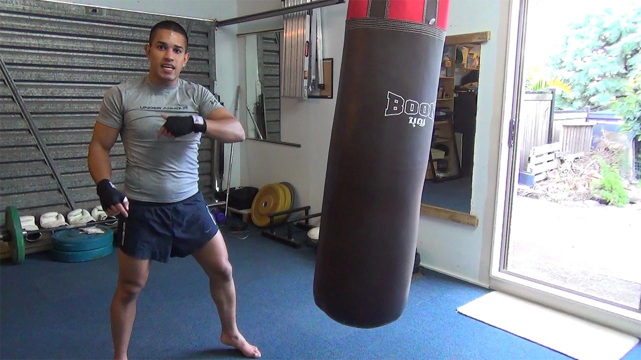 how to punch a boxing bag