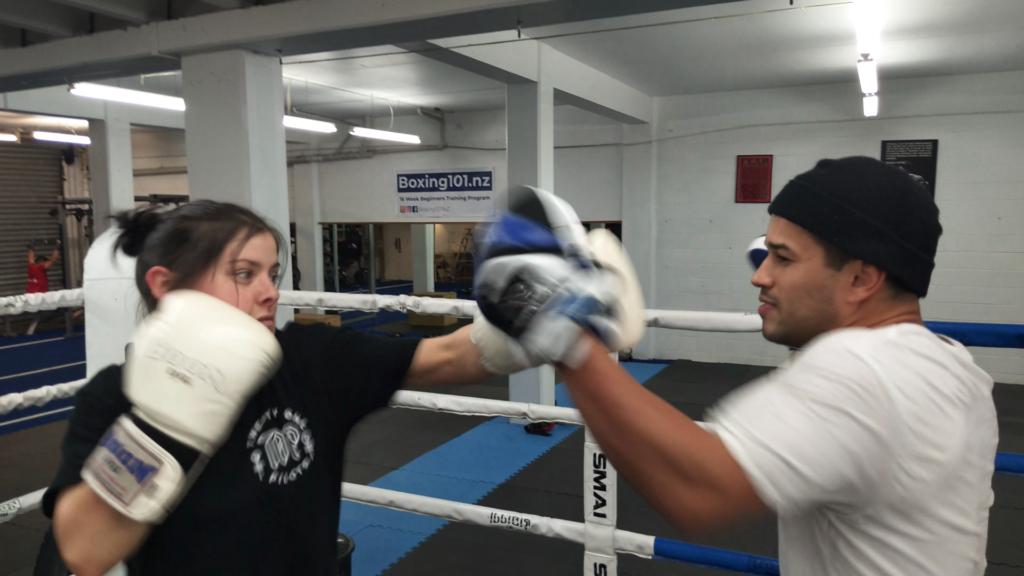 female boxing pad work